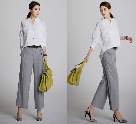 Chỉn chu hơn, bạn có thể diện quần ống rộng với áo sơ mi. Sơ vin vạt trước của áosẽ giúp bạn thêm gọn gàng hơn chốn công sở.