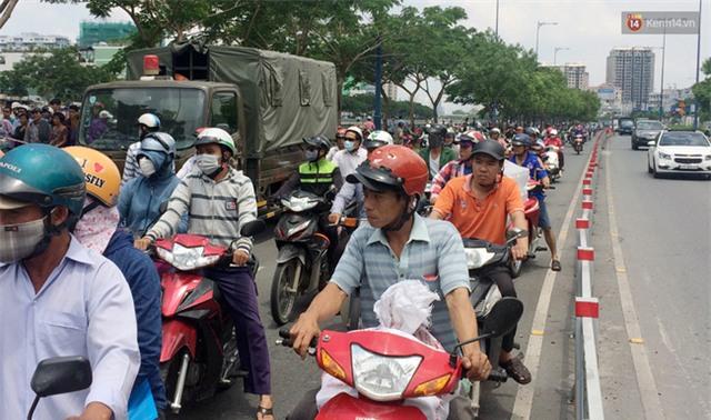 Với tay cứu cháu bị trượt chân, 2 ông cháu chết đuối thương tâm ở Sài Gòn - Ảnh 2.