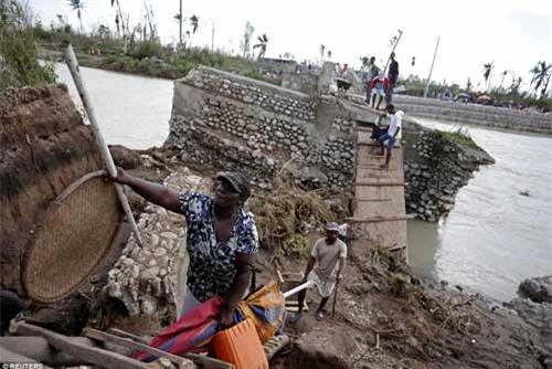 Cảnh hoang tàn và chết chóc ở Haiti sau cơn bão lịch sử Matthew - 12