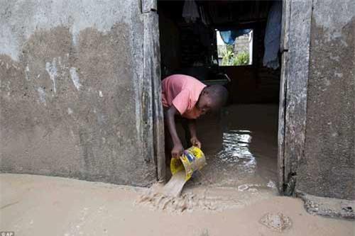Cảnh hoang tàn và chết chóc ở Haiti sau cơn bão lịch sử Matthew - 18