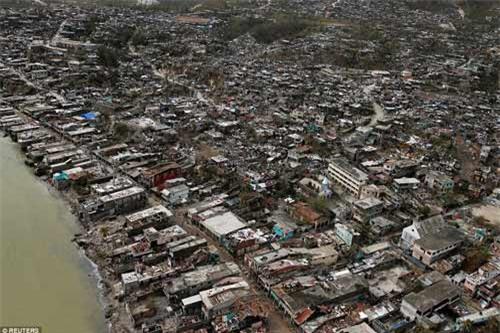 Cảnh hoang tàn và chết chóc ở Haiti sau cơn bão lịch sử Matthew - 4