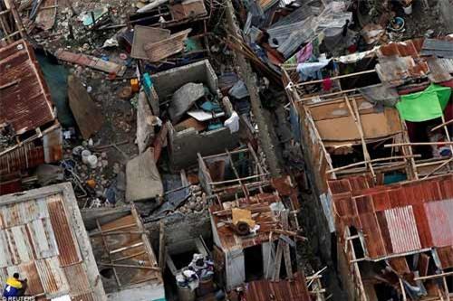 Cảnh hoang tàn và chết chóc ở Haiti sau cơn bão lịch sử Matthew - 8