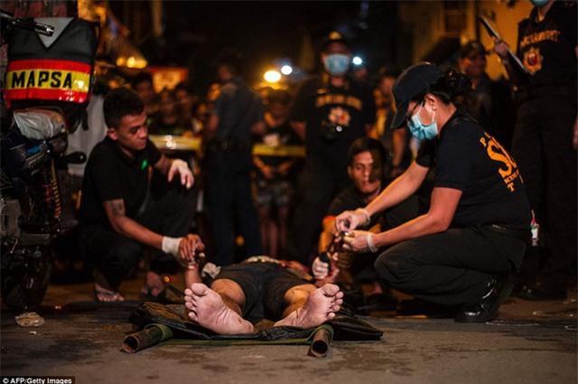 Chùm ảnh: Hơn 3.700 người đã chết trong cuộc chiến chống tội phạm ma túy ở Philippines - Ảnh 6.
