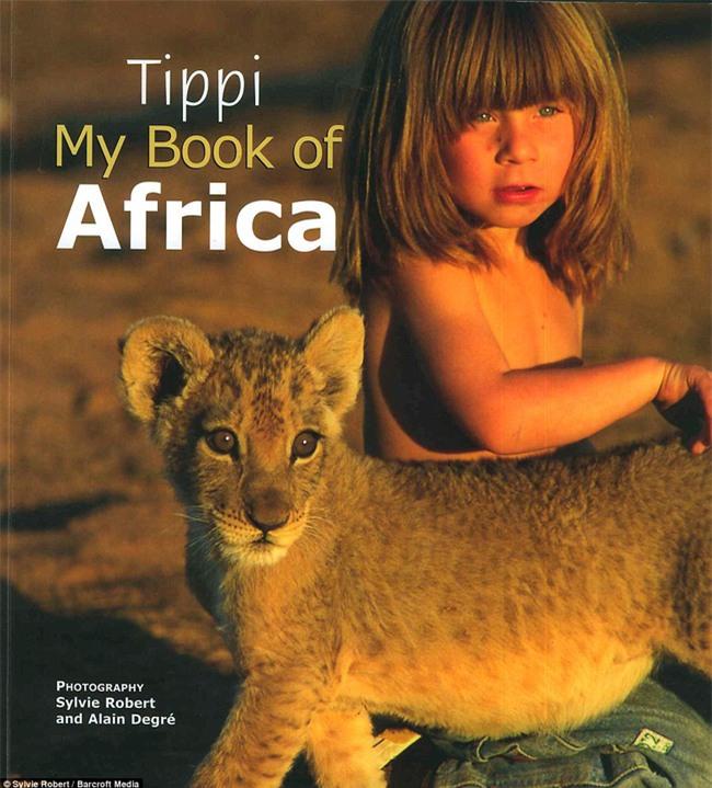Cuộc sống của cô bé rừng xanh ngoài đời thật, làm bạn với voi châu Phi và chơi cùng báo - Ảnh 31.