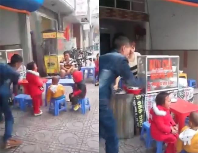 Clip gây phẫn nộ: Ông bố địu con nhặt rác dùng thắt lưng đánh con gái dã man trên phố - Ảnh 1.