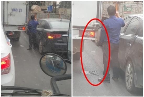 Ông bố mở cửa ô tô cho con đi vệ sinh khi dừng đèn đỏ ngay trên phố Hà Nội - Ảnh 5.