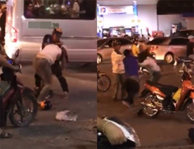 Đôi nam nữ chửi mắng, đánh đập nhau dã man giữa phố đông người - Ảnh 1.