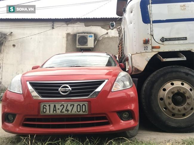 Xế hộp Nissan bị xe container đẩy lùi hàng chục mét, anh trai đạp cửa cứu 2 em - Ảnh 8.