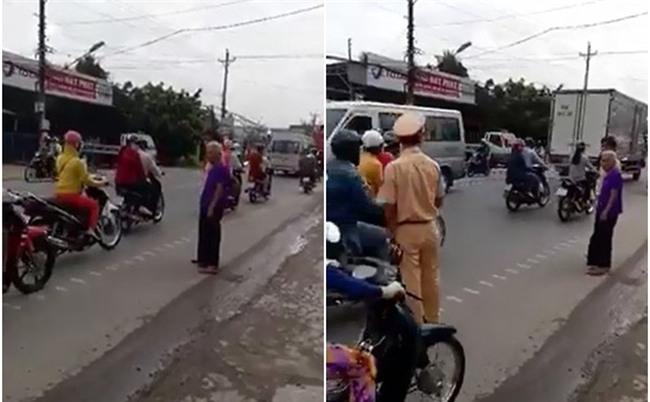 Hình ảnh CSGT cùng cụ bà giữa đường khiến nhiều người phải ngoái nhìn