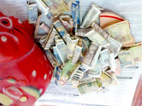 Mỗi ngày bỏ ống heo 50.000 đồng thôi, số tiền bạn tiết kiệm được dư đóng 1 năm học phí cho con - Ảnh 1.