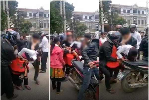 Cô gái bị kéo tuột váy vì nhóm thanh niên đi bắt vợ tại trung tâm chợ thị trấn Phù Yên - Ảnh 1.