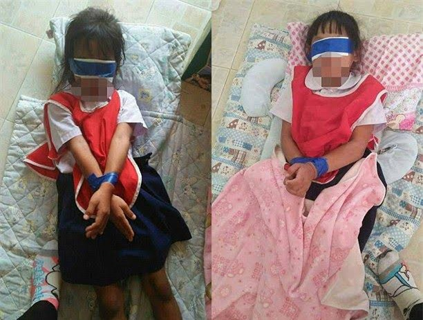 Hai học sinh bị phạt bịt mắt và trói tay chân vì tội xé giấy trong giờ học - Ảnh 1.