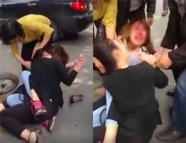 Sau va chạm giao thông, hai cô gái lao vào túm tóc, giằng co giữa phố Hà Nội - Ảnh 1.