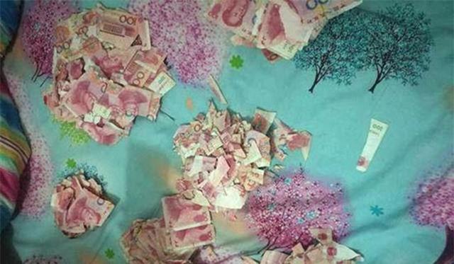 Những đồng tiền 100 Nhân dân tệ bị xé vụn. (Ảnh: SCMP)
