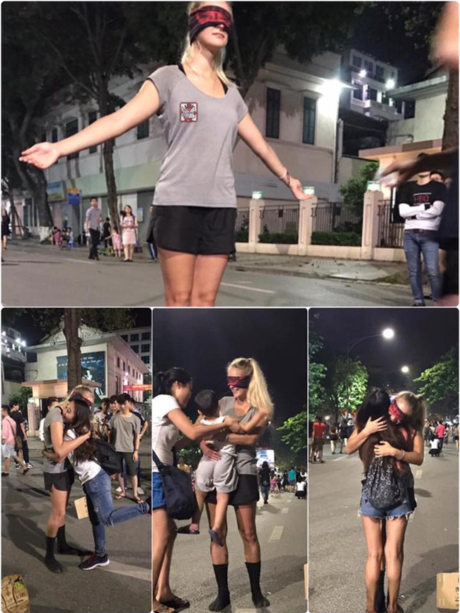 Cô gái ngoại quốc xinh đẹp bịt mắt, dang tay free hugs gây náo loạn phố đi bộ Hà Nội - Ảnh 1.