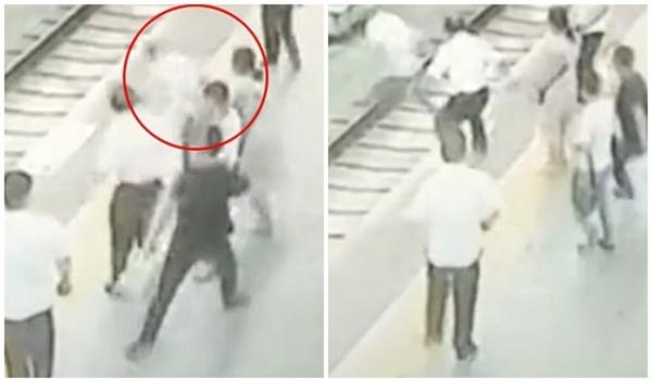 Clip: Bị sàm sỡ, người phụ nữ đẩy đối phương ngã sấp mặt xuống đường ray tàu hỏa - Ảnh 2.