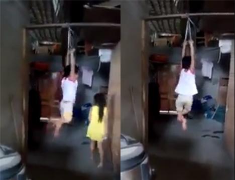 Phẫn nộ đoạn clip bé trai bị buộc 2 tay khóc thét giãy dụa trên kèo nhà - Ảnh 3.