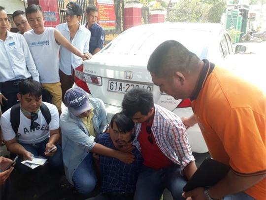 Tóm được Việt kiều trộm ô tô ở tòa nhà Becamex - Ảnh 1.