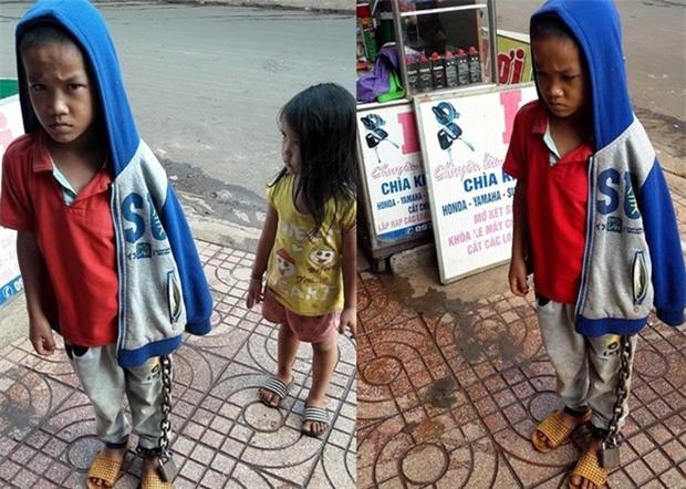 Hình ảnh bé trai bị xích chân giữa chợ khiến nhiều người bức xúc - Ảnh 1.