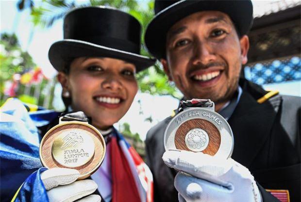 Bà bầu xinh đẹp người Malaysia giành HC vàng SEA Games môn đua ngựa - Ảnh 2.
