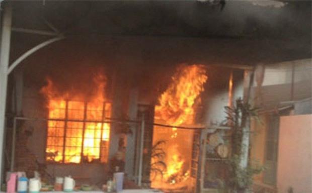 Châm lửa đốt con gái riêng của vợ đến tử vong - Ảnh 1.