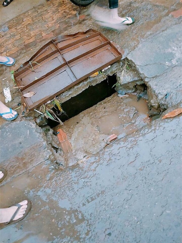 Tìm thấy thi thể nữ sinh bị nước cuốn trôi xuống cống - Ảnh 1.