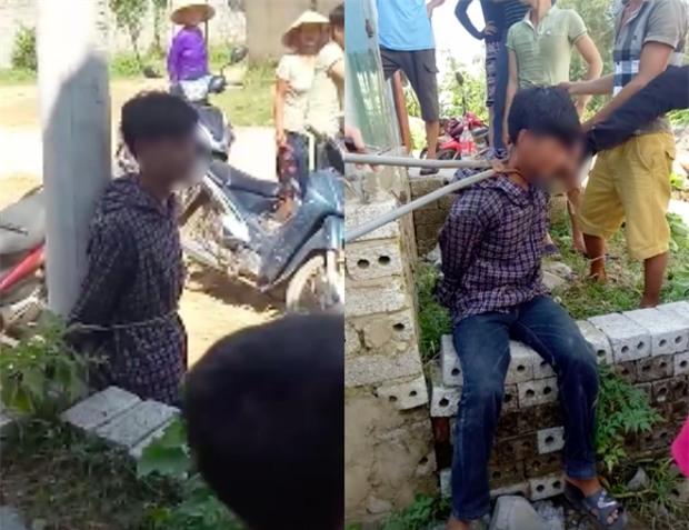 Xôn xao clip nam thanh niên trộm gà bị người dân dùng kìm kẹp cổ, trói vào cột điện - Ảnh 1.