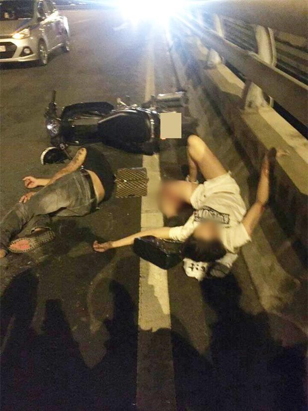 Hà Nội: Cô gái trẻ bị gãy gập chân vẫn bình tĩnh nằm bấm điện thoại sau va chạm giao thông - Ảnh 1.