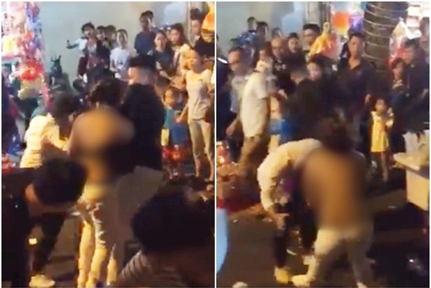 Xôn xao clip người phụ nữ bị lột sạch áo vẫn hùng hổ lao vào đánh nhau ở phố Hàng Mã đêm Trung thu - Ảnh 2.