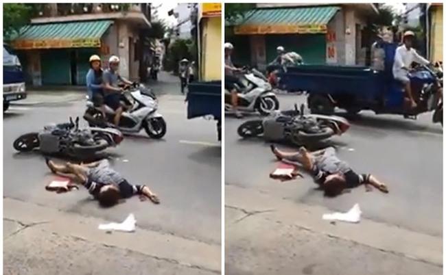 Người phụ nữ co giật vì tai nạn giao thông và cái nhìn lạnh lùng của người đi đường