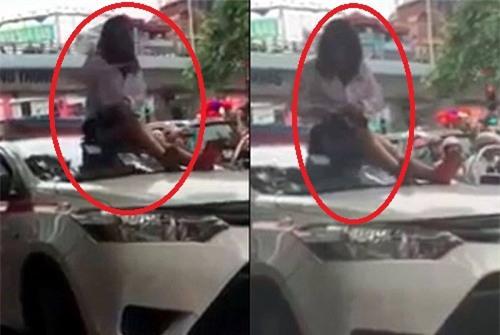 Bị CSGT dừng xe vì vượt đèn đỏ, nữ tài xế taxi trèo lên nóc xe ăn vạ