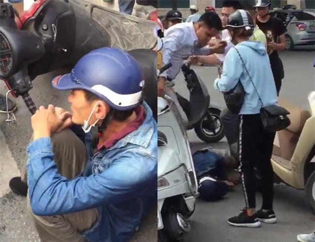 Clip: Nam thanh niên lao thẳng xe máy, chặn bắt đối tượng nghi dàn cảnh giật balo của một phụ nữ trên phố Hà Nội - Ảnh 3.