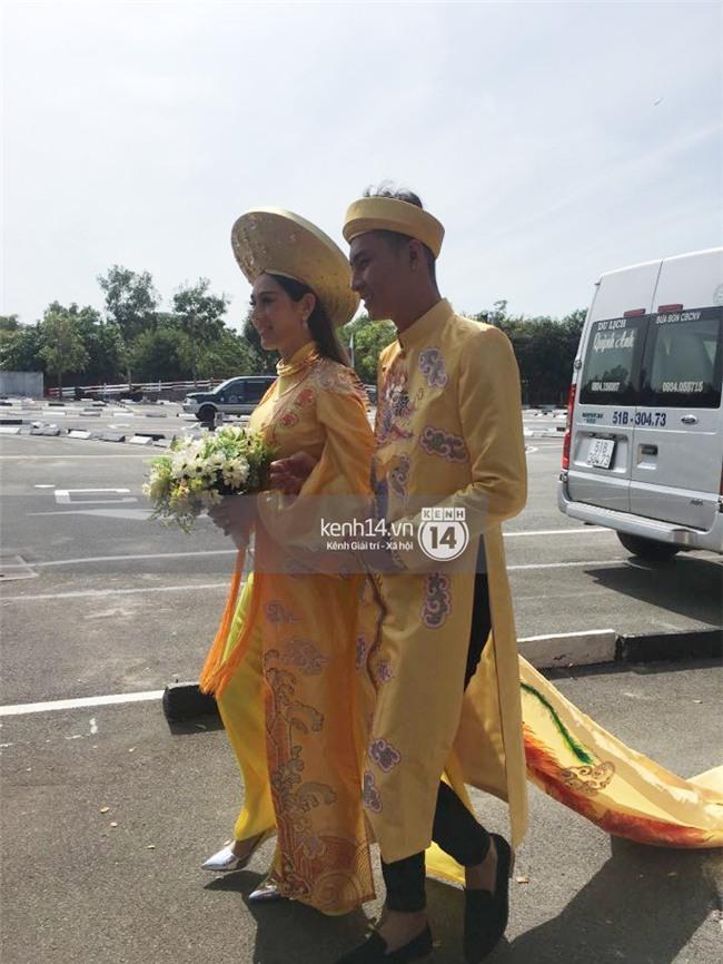 Cô dâu Lâm Khánh Chi diện áo dài long phụng quét đất về nhà chồng - Ảnh 10.