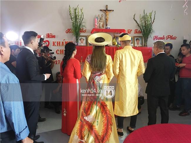 Cô dâu Lâm Khánh Chi diện áo dài long phụng quét đất về nhà chồng - Ảnh 12.