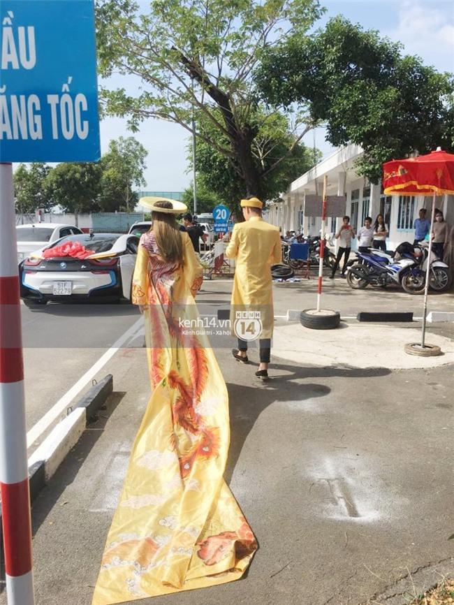 Cô dâu Lâm Khánh Chi diện áo dài long phụng quét đất về nhà chồng - Ảnh 5.