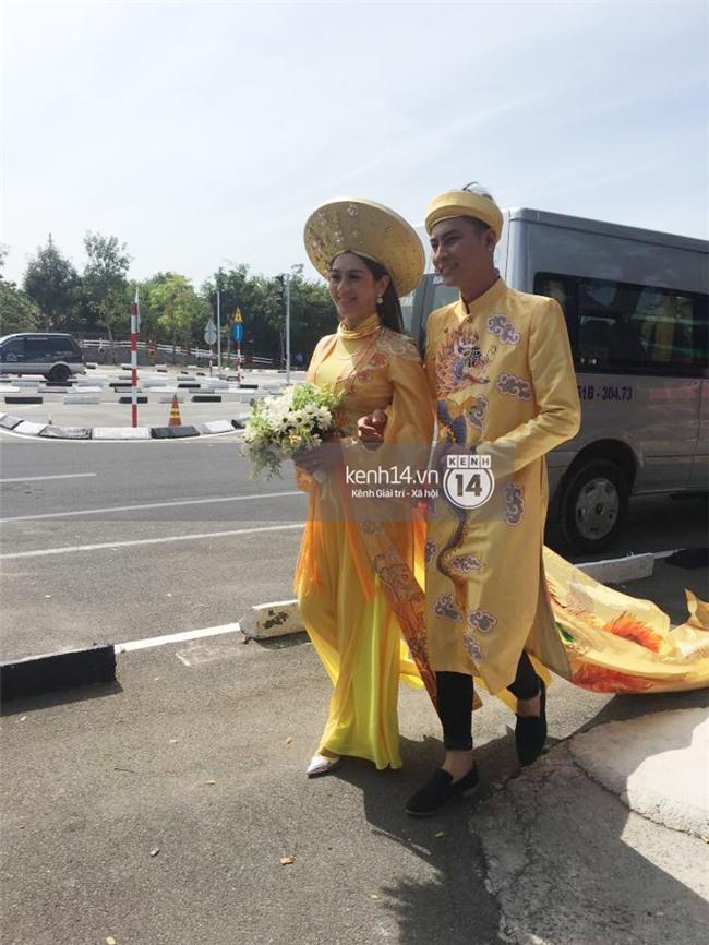 Cô dâu Lâm Khánh Chi diện áo dài long phụng quét đất về nhà chồng - Ảnh 7.