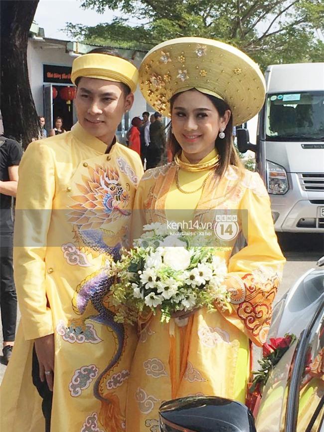 Cô dâu Lâm Khánh Chi diện áo dài long phụng quét đất về nhà chồng - Ảnh 9.