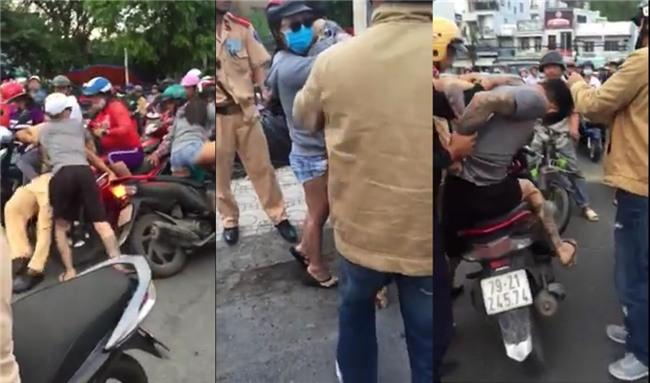 Tạm giam nam thanh niên tấn công CSGT để giải cứu bạn gái ở Nha Trang - Ảnh 2.