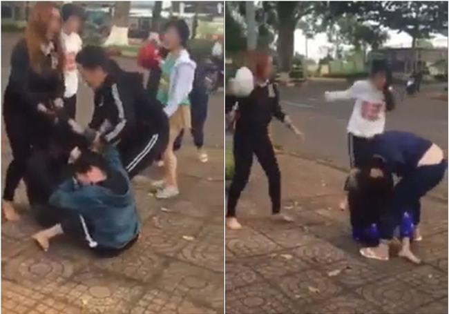 Clip 2 nhóm nữ sinh dùng mũ bảo hiểm đánh nhau khiến nhiều người bức xúc - Ảnh 1.