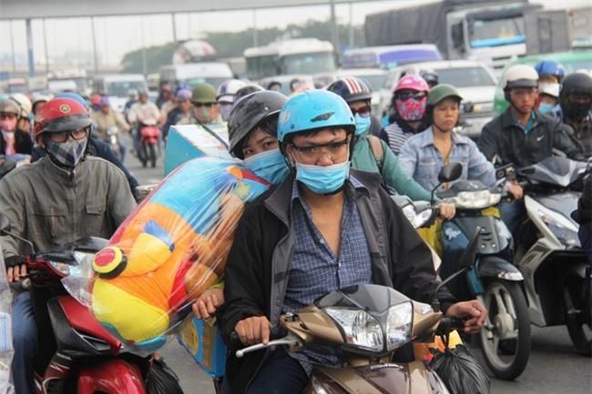 Ngày chủ nhật cuối cùng trong năm, người miền Tây ùn ùn về quê ăn Tết khiến Quốc lộ 1A kẹt cứng - Ảnh 5.