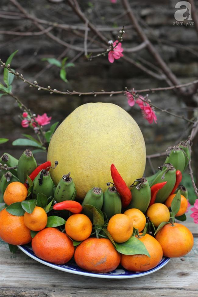 Cách chọn trái cây và bày mâm ngũ quả đẹp mang may mắn cả năm - Ảnh 1.