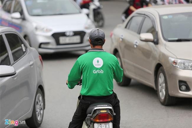 Uber, Grab: Ngay thuong 80.000 dong, can Tet 180.000 dong hinh anh 1