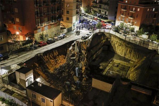 Chỉ sau một đêm, người dân bàng hoàng nhìn hố sâu 9m khổng lồ nuốt gọn nhiều ô tô, nhà cửa - Ảnh 6.