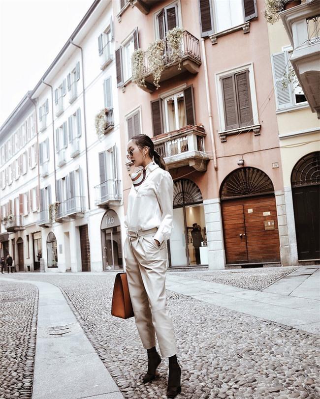 Diện quần âu và sơmi cách điệu đẹp như các quý cô châu Á trong street style đầu tháng 3 - Ảnh 1.