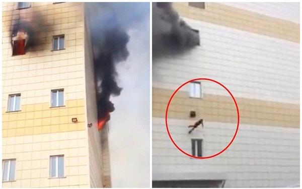 Khoảnh khắc kinh hoàng khi câu bé 11 tuổi lao mình khỏi đám cháy từ độ cao 12m, cha mẹ không ai sống sót - Ảnh 1.