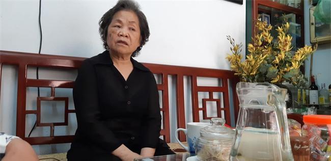 Hà Nội: Nỗi đau của gia đình bảo vệ siêu thị ngã xuống đất tử vong sau khi giằng co chiếc ô che nắng với dân phòng - Ảnh 3.