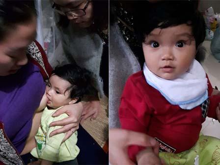 Rớt nước mắt cảnh bé 5 tháng tuổi mất cha mẹ vồ vập bú chực người đến thăm