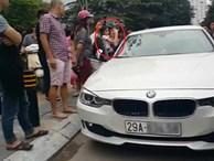 Bố dùng búa đập vỡ kính xe BMV để giải cứu con gái
