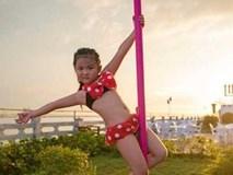 Hình ảnh bé gái mặc bikini múa cột khiến dư luận