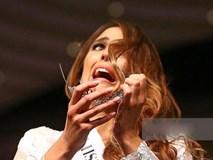 Hoa hậu Australia nhăn nhó vì vương miện liên tục rơi khỏi đầu